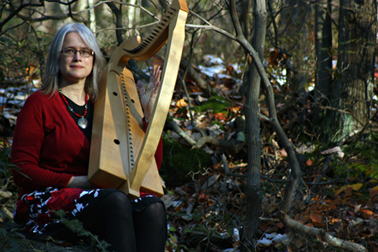 photograph of Cynthia with a harp